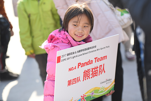 child holding sign