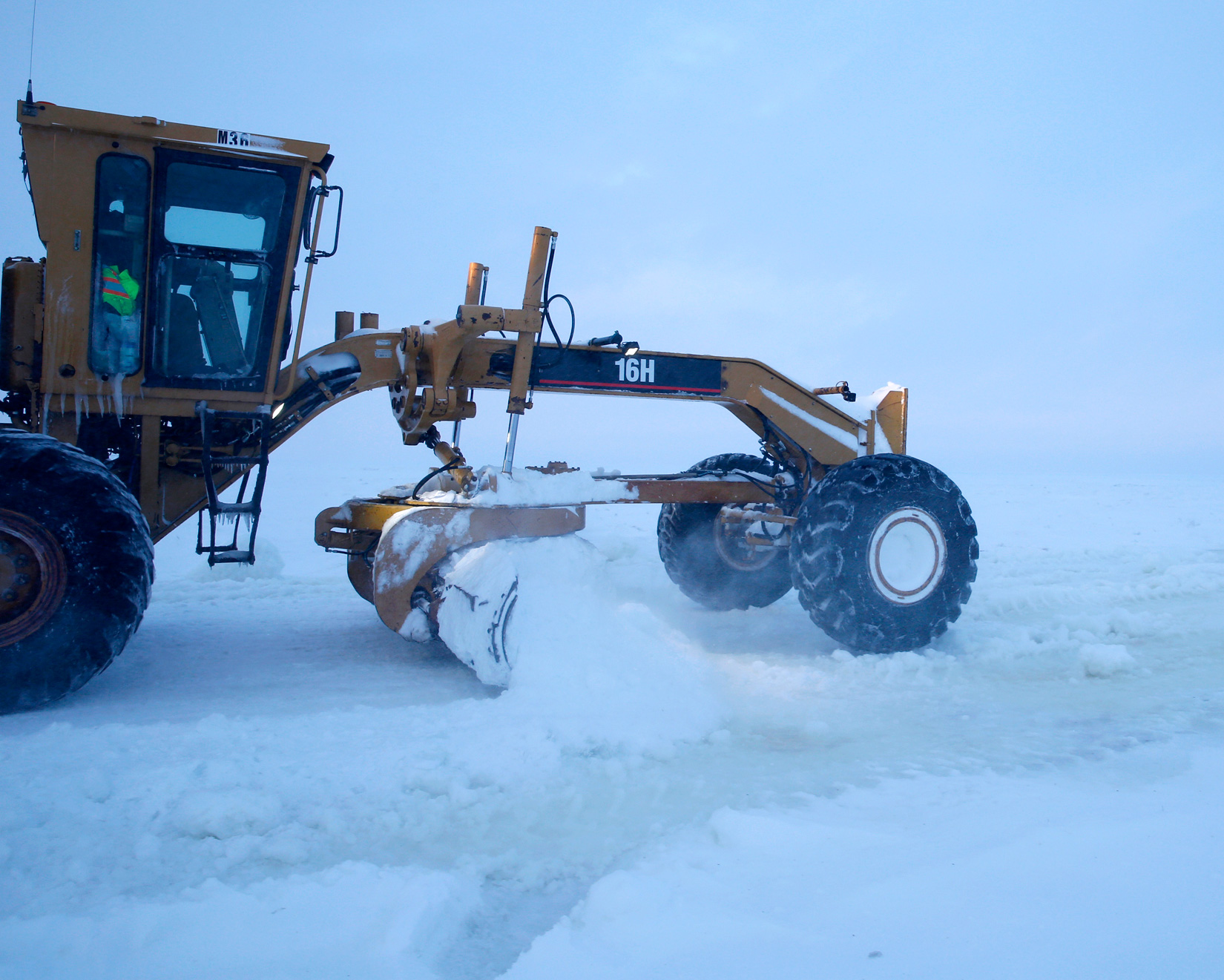 ice road grader plowing