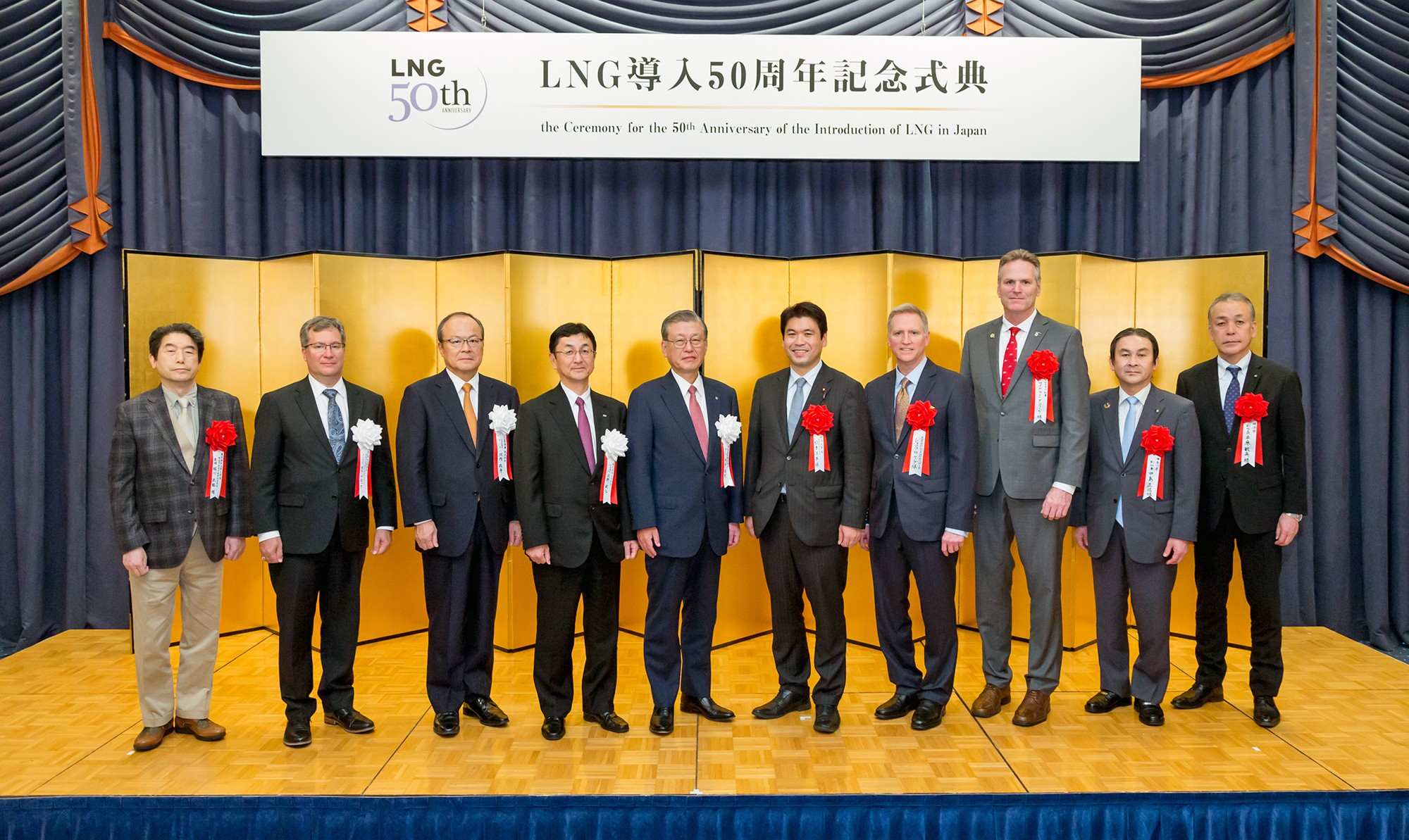 At a celebration commemorating the 50th anniversary of LNG in Japan, from left: Professor Takeo Kikkawa, Tokyo University of Science; Bill Bullock, president, ConocoPhillips Asia Pacific & Middle East; Takehiko Kakiuchi, president, Mitsubishi Corporation; Toshihiro Sano, chairman, JERA; Takashi Uchida, president, Tokyo Gas; Deputy Minister of Economy, Trade and Industry Yohei Matsumoto; Joseph Young, charge d'affaires. U.S. Embassy; Alaska Governor Michael Dunleavy; Masanobu Nakajima, deputy governor, Kanagawa Prefecture; and Toshihide Hirahara, deputy mayor, Yokohama City