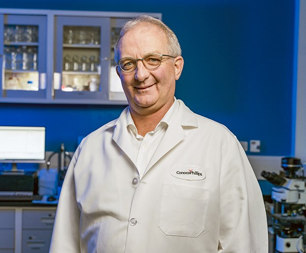 Arnie Janson wearing lab coat in laboratory