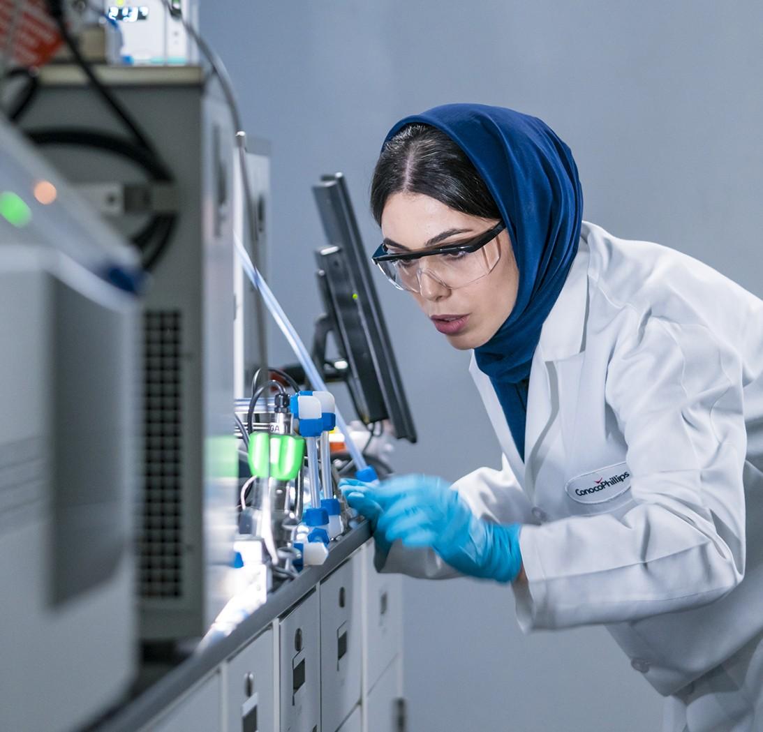 Dareen Dardor examining water vials in laboratory