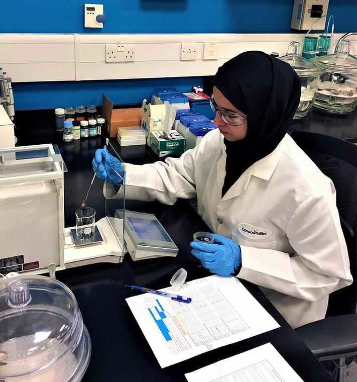 Eman Al Shamari testing water in a beaker
