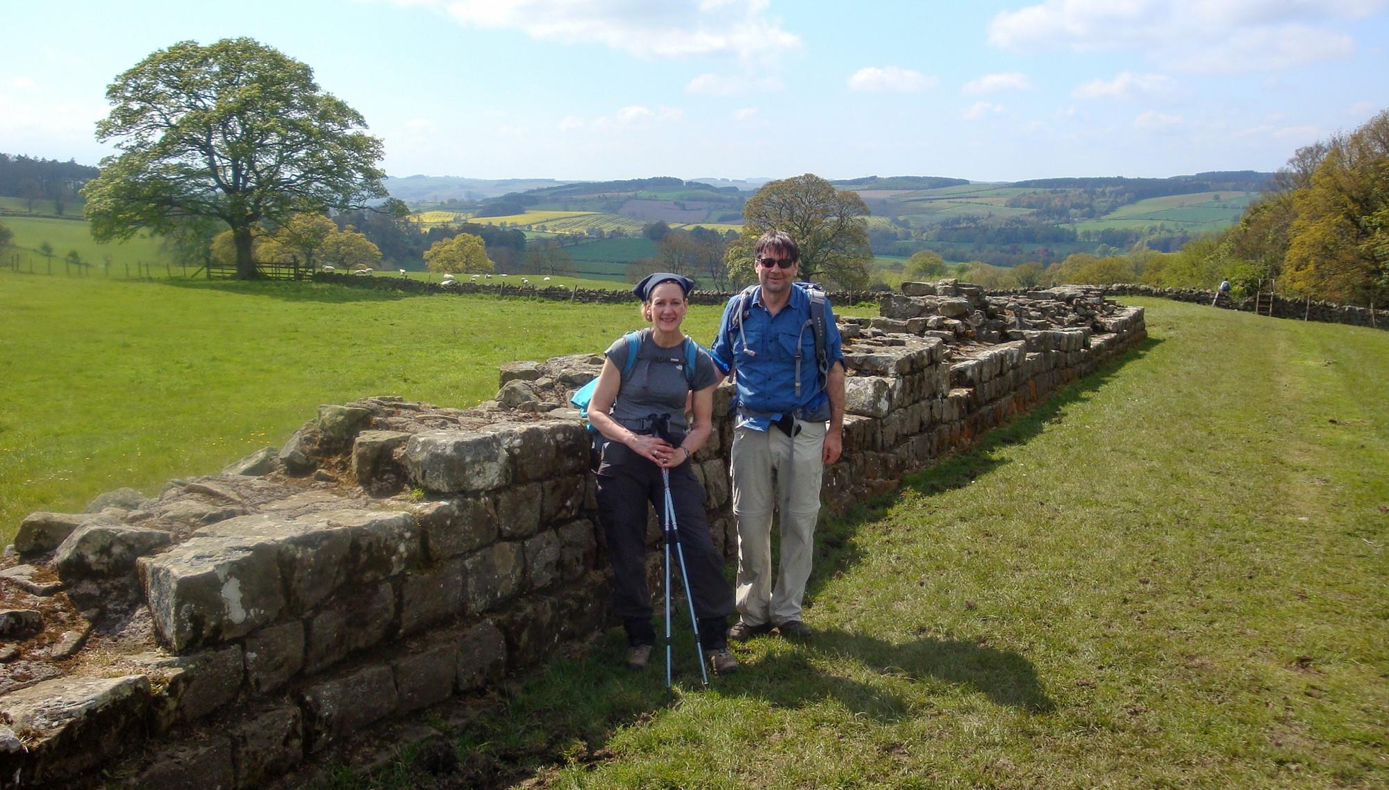Marjorie and Rich alongside rock wall