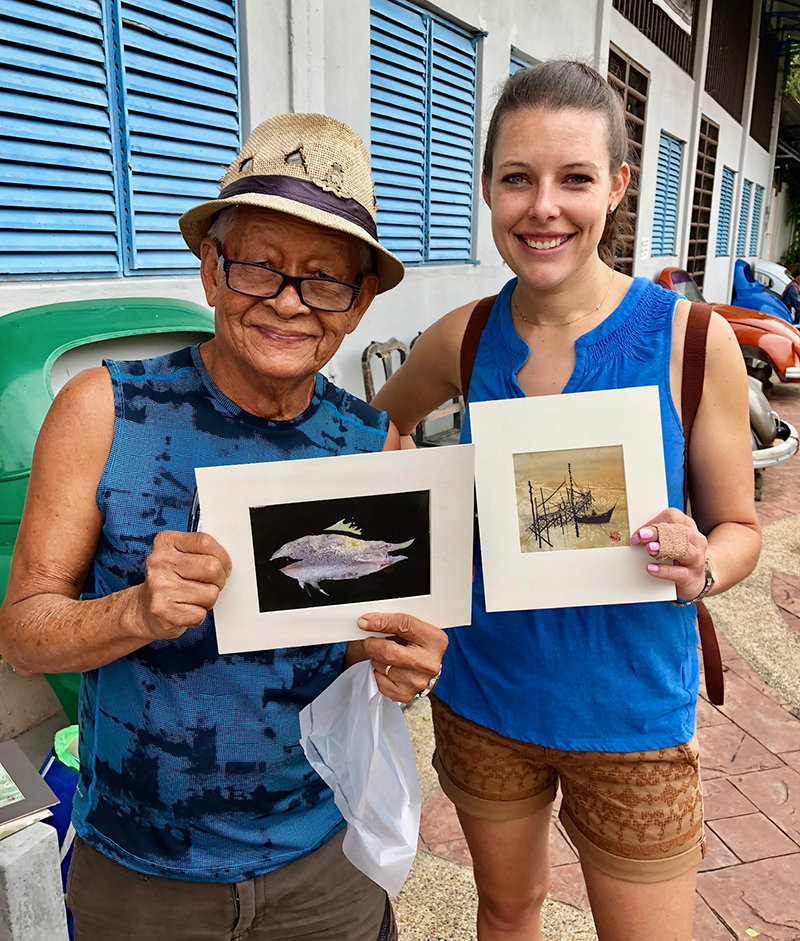 artist and Laura holding artwork