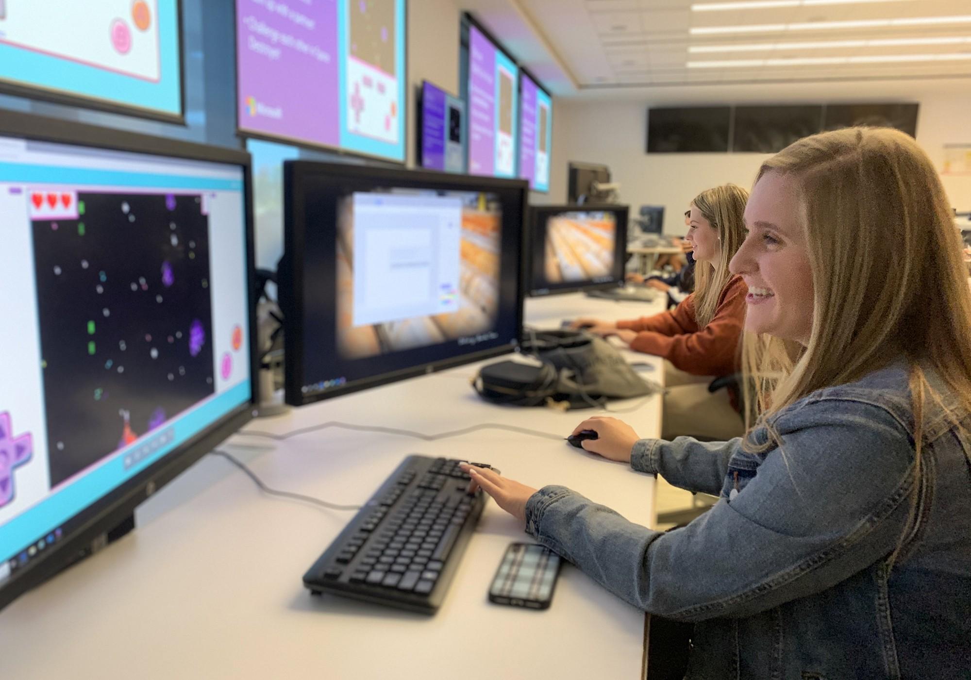 students at computer screens
