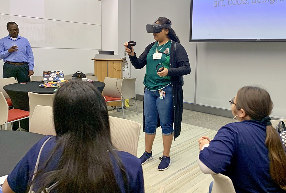 student using virtual reality device