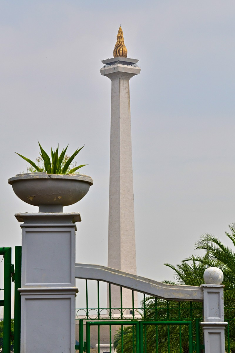 monument of pillar with flame on top