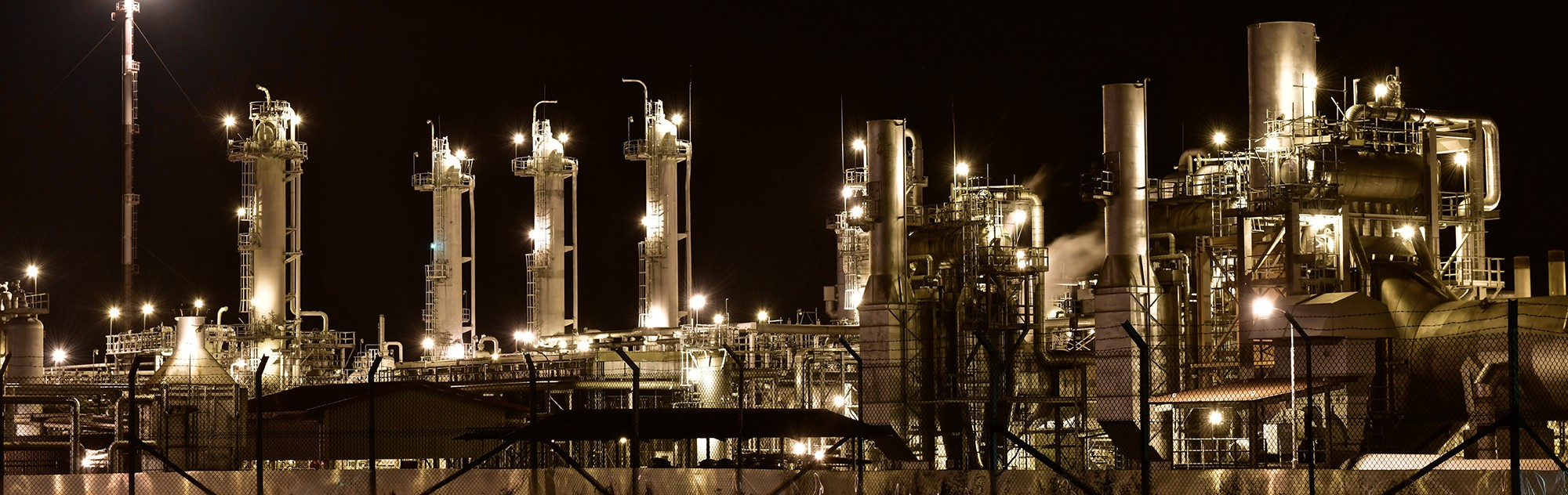 panoramic refinery lit up at night