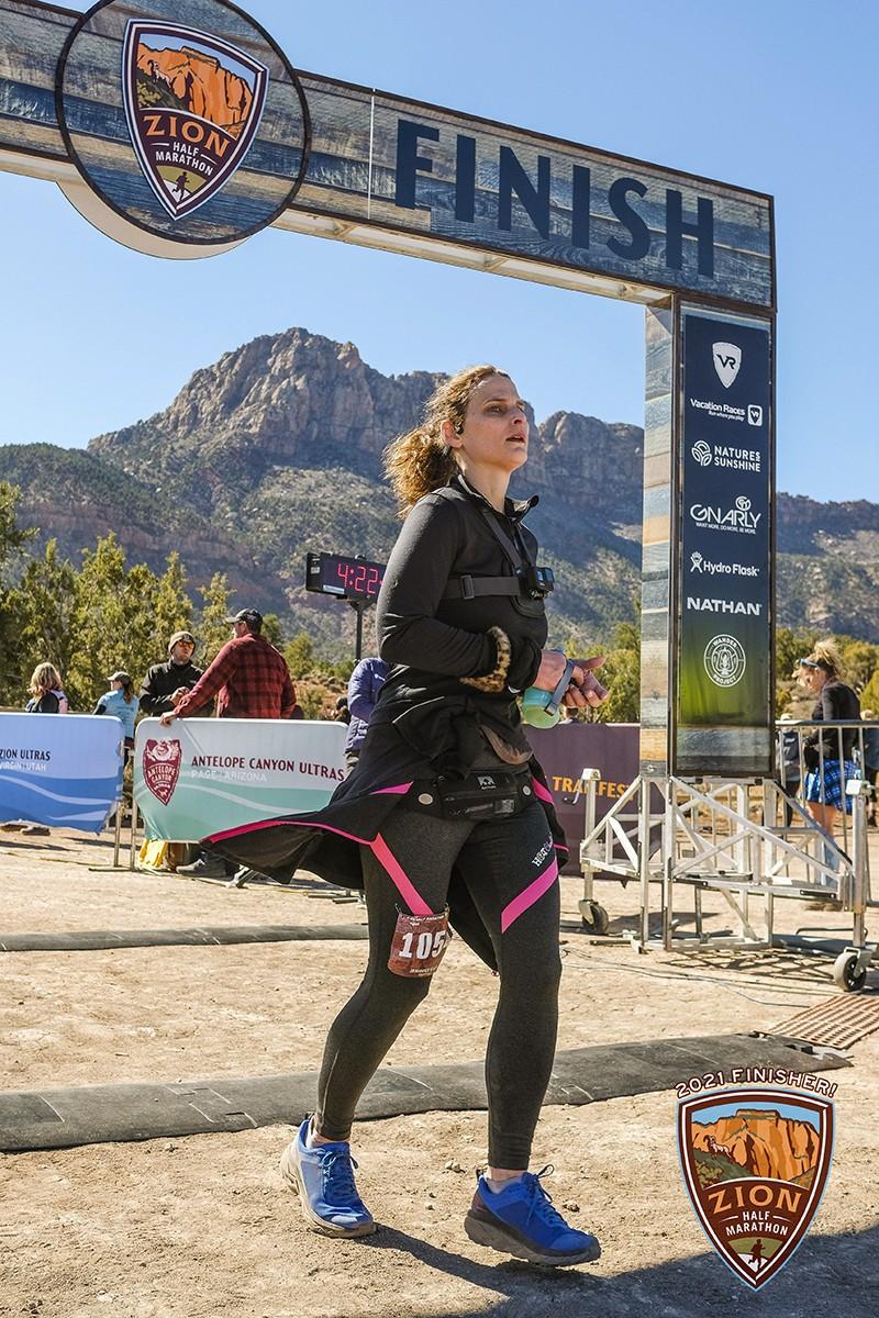 Jennifer crosses the finish line during the Zion Half Marathon.