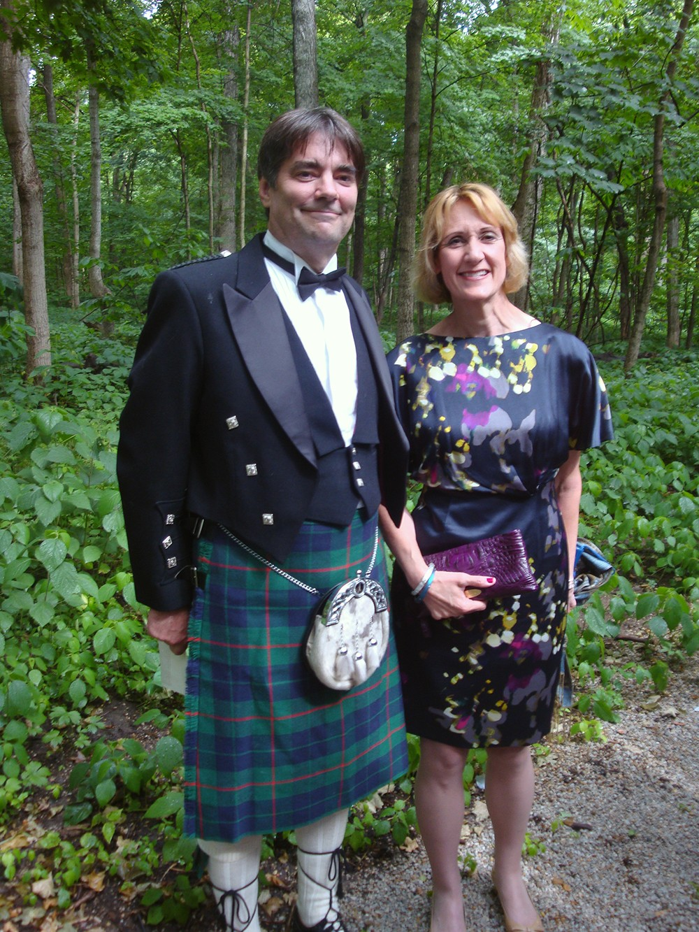Marjorie and Rich with wooded background