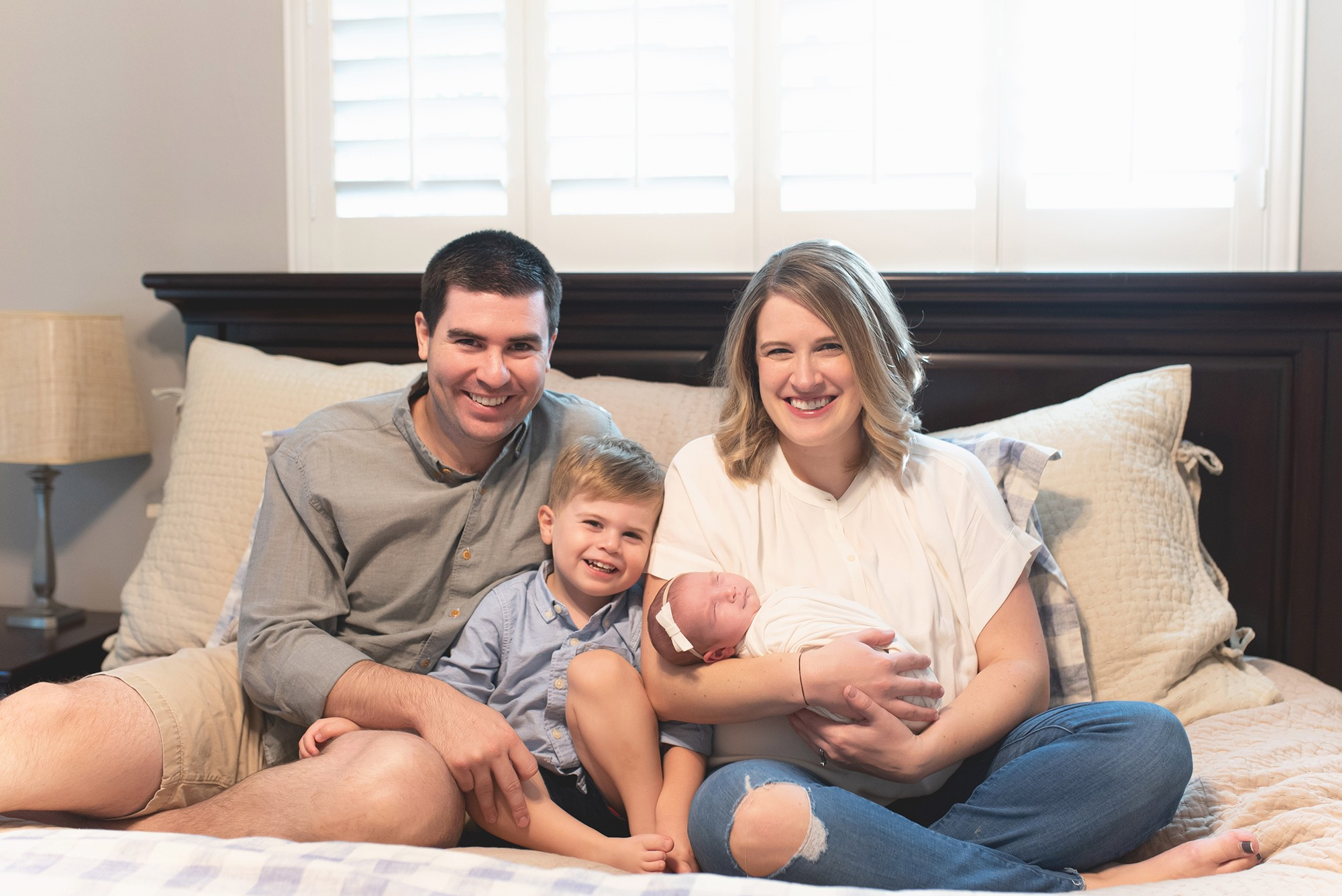 Matt and Abby Meade are pictured with their son, Graham, and newborn daughter,  Cameron.