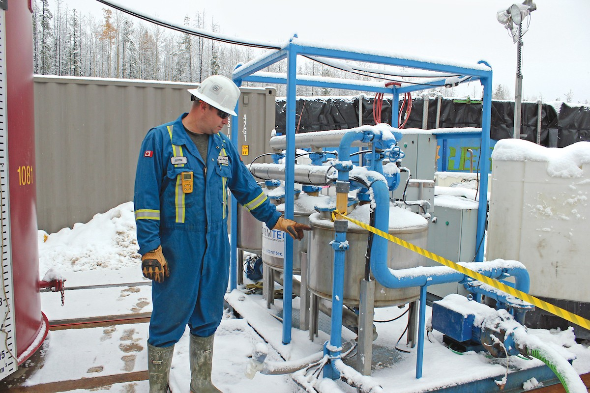 Well Site Supervisor inspecting media filter vessels