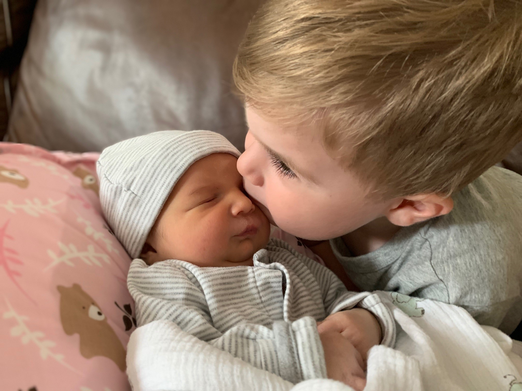 Graham Meade, 3, kisses his sister, Cameron Meade, who was born Aug. 23, 2019.