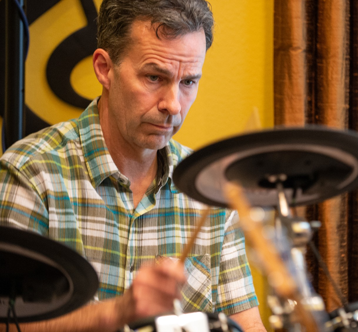Bret Fossum concentrates while hitting cymbal.