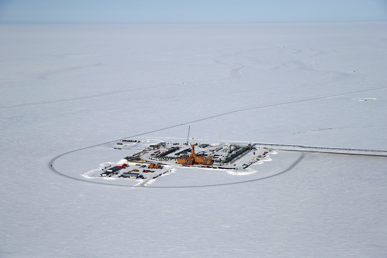Aerial view of drilling rig surrounded by snow